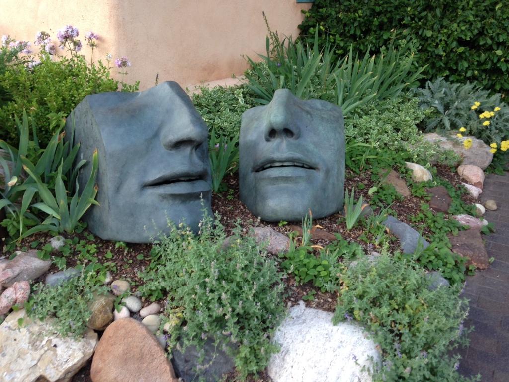 Sculpted garden faces in Santa Fe