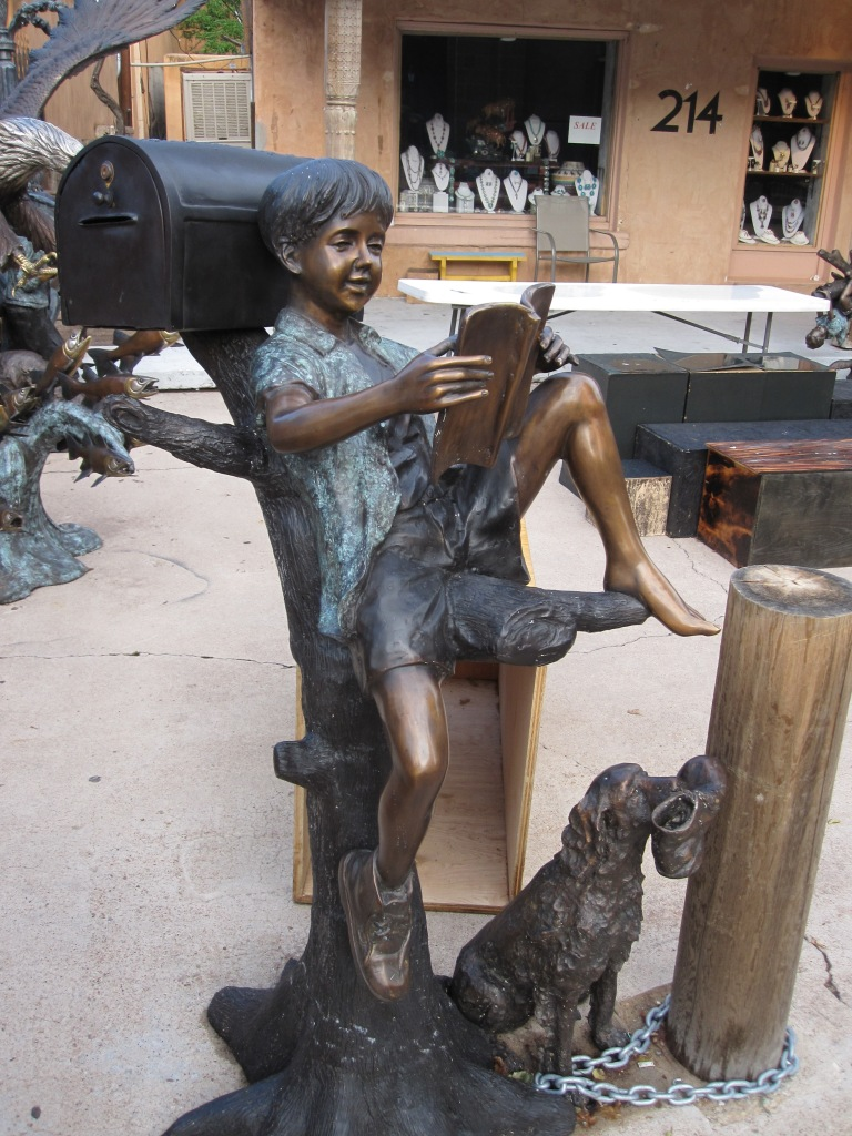 Sculpture of a child reading in Santa Fe