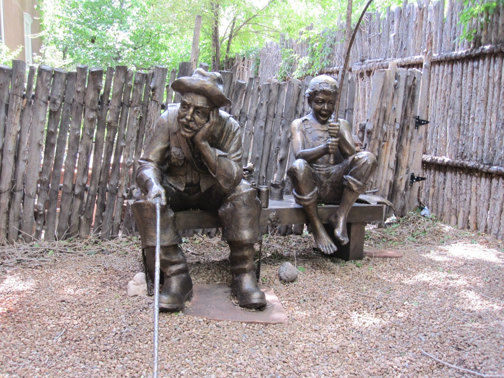 Sculpture of man and boy fishing in Santa Fe