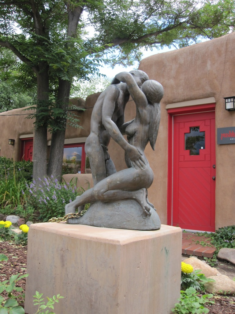 Sculpture of nude couple kissing in Santa Fe